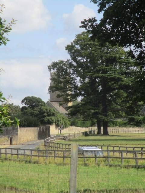 St. Faith's in the distance -  immaculate walls and fencing in this estate