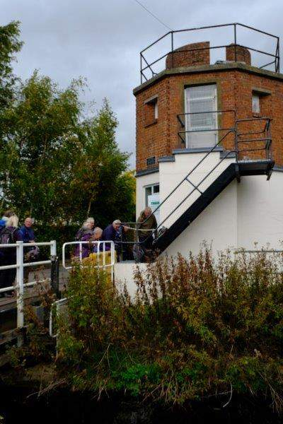 At the old pillbox a Canal Trust volunteer talks to us - specially  arranged by Dave