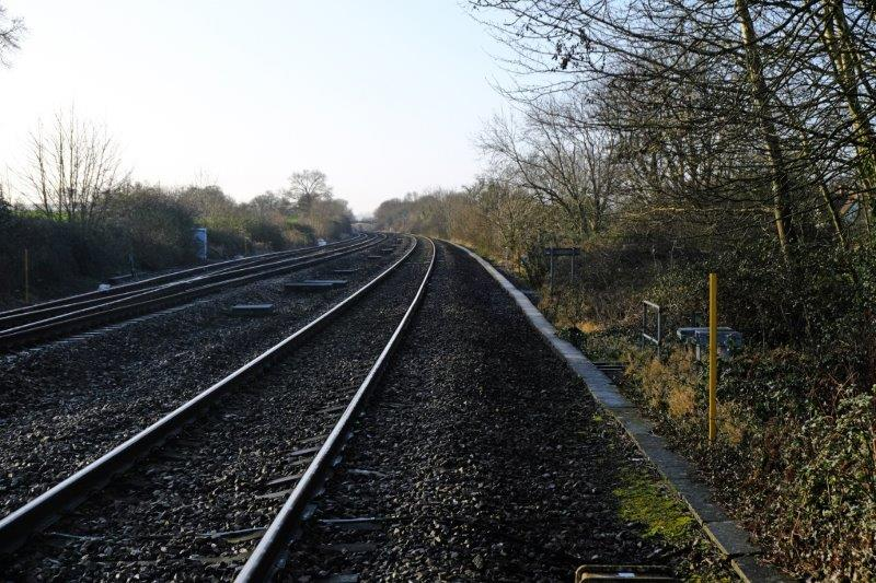 Leaving the pub we cross the railway