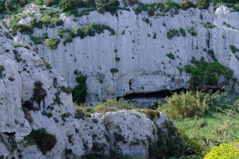 Today we walk uphill from our hotel past this rock face eith It-Toqba  Ta'Krista - cavity of Jesus Christ to you and me
