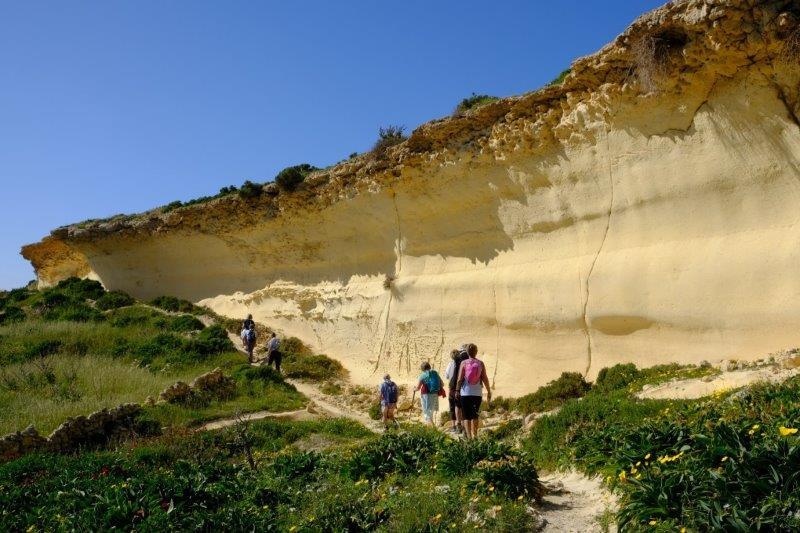 Our path passing under sandstone cliffs