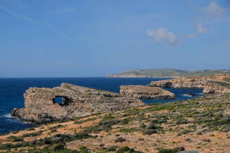 Looking back up the coast, Gozo in the distance