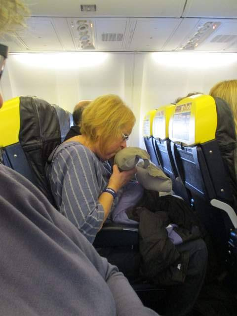 Margaret prepares to relax on our Ryanair flight which left and arrived in Malta on time