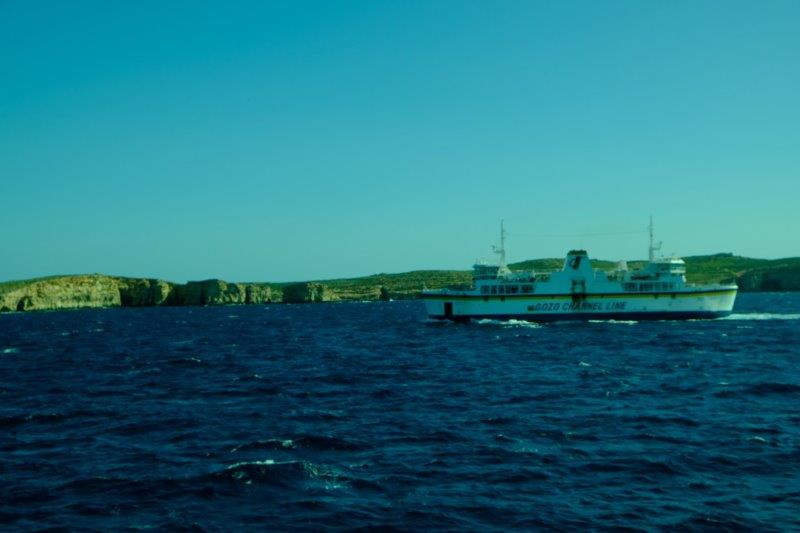 Passing the ferry coming the other way with Comino in the background