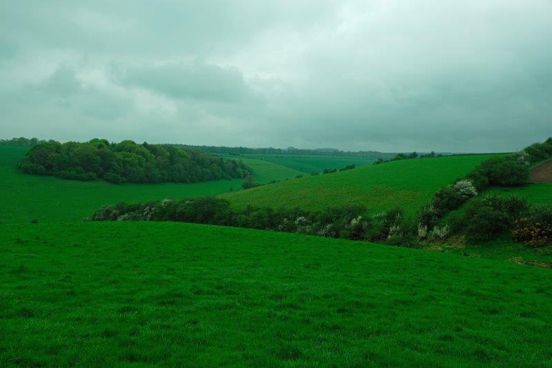 As we look across the rolling countryside to leaden hills