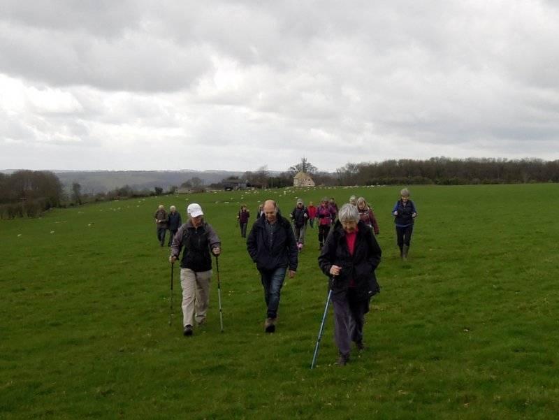 We cross a large hilltop field