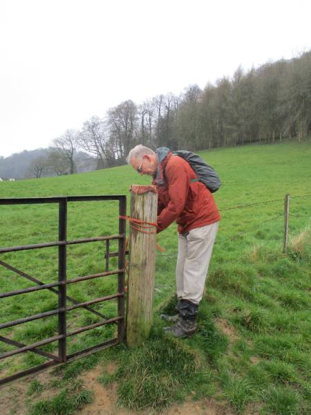 Steve conscientiously reties a much-knotted gate
