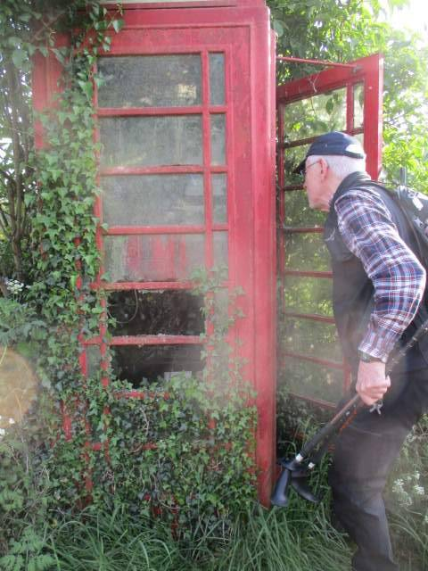 Mike inspects the even more decrepit phone box