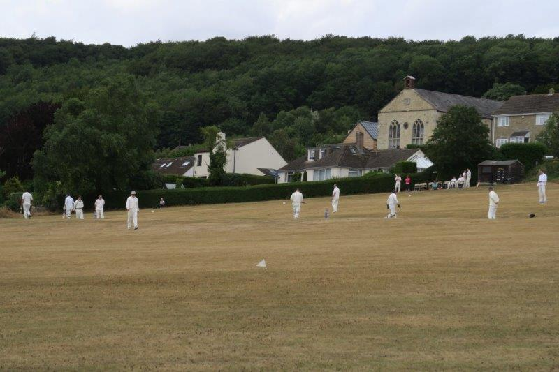 We approach Randwick across a cricket pitch