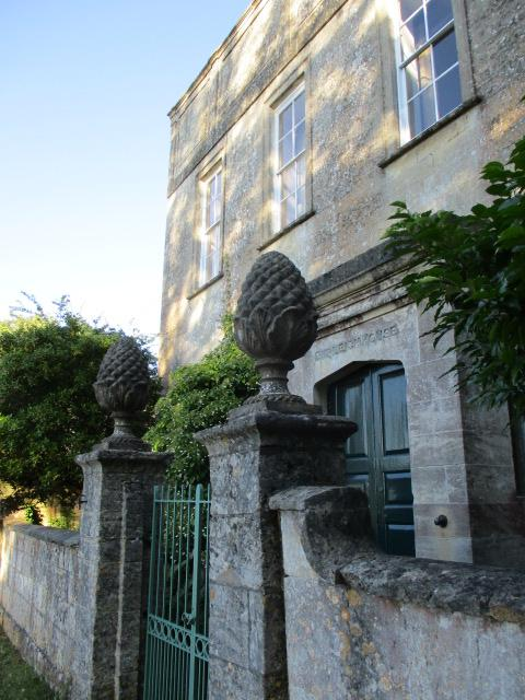 Past Burleigh House and its pineapples