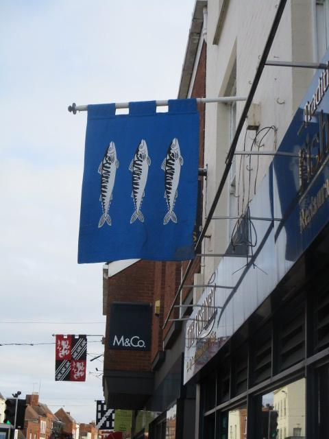 The banners are out, this one appropriately above a fish and chip shop