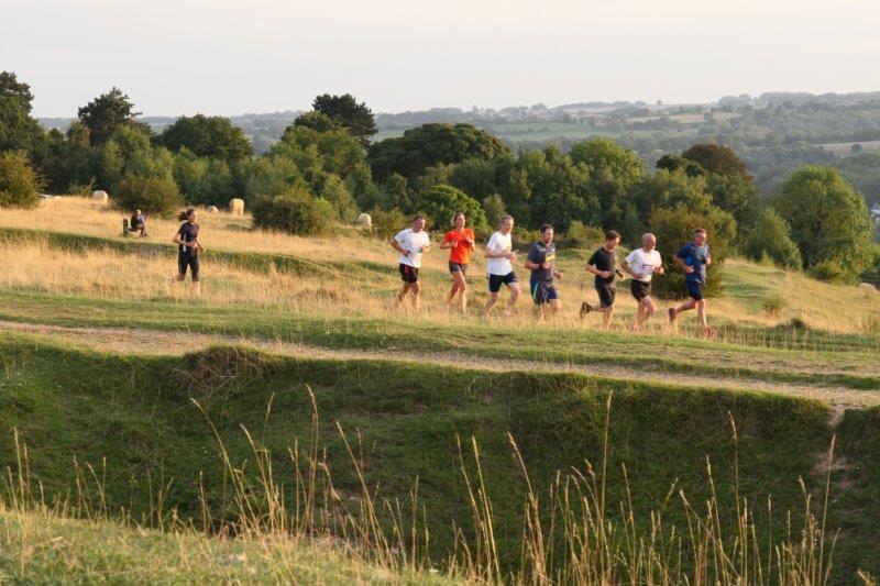 Runners crossing Rodborough Common