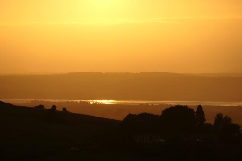 The sun setting over the Severn