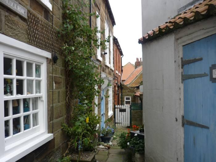 We explore little alleyways between houses