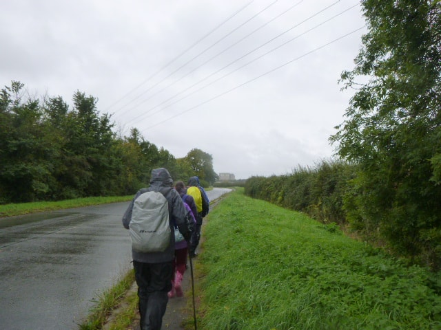We walk along the road towards the power station
