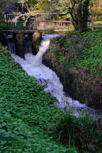 The Painswick Stream gushing down over a weir