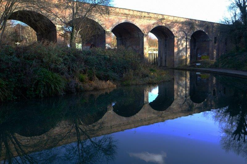 Viaduct reflected in the water