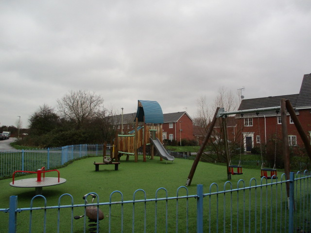 A playground for this estate - note artificial grass