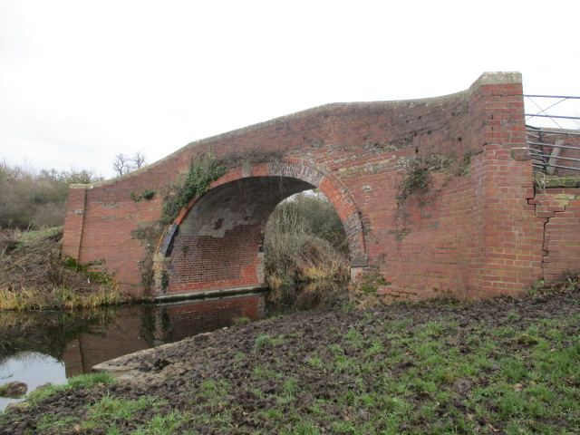 A nice old brick bridge with cracks in
