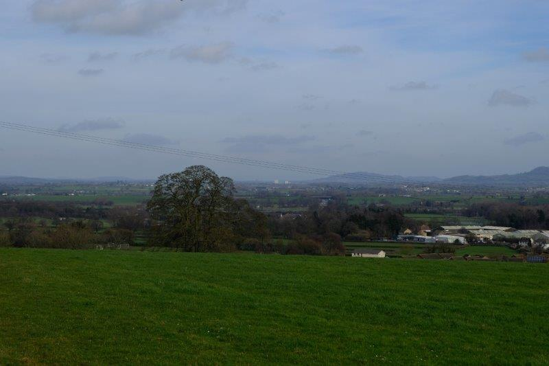 Views now of more distant hills and an incinerator
