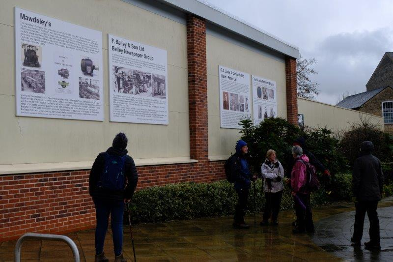 Outside Sainsburys studying the information boards