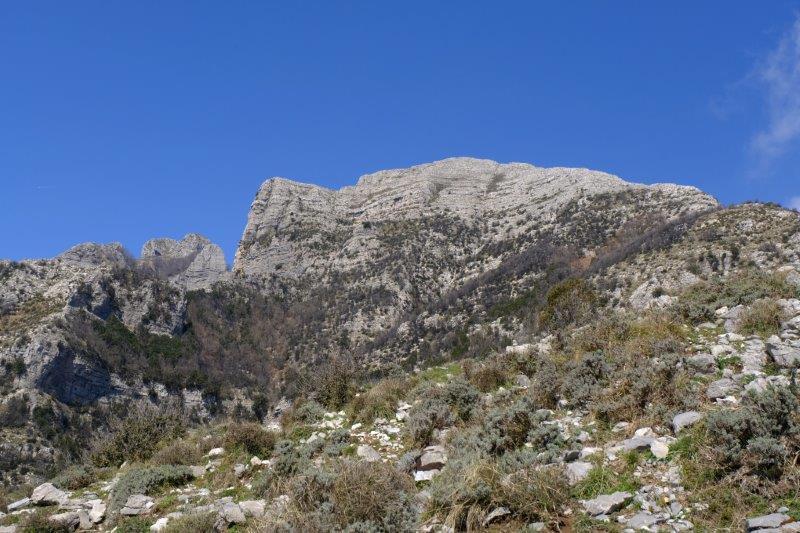 Beneath a towering mountain