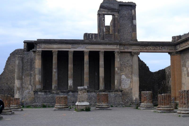 Has more two storey buildings than Herculaneum as damage was done by ash rather than lava