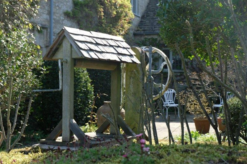 An old well in a cottage garden
