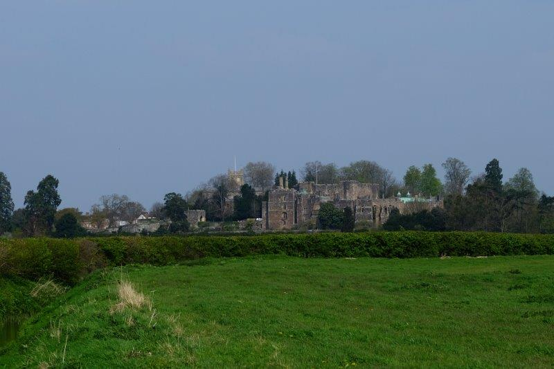 The castle now showing up across the fields