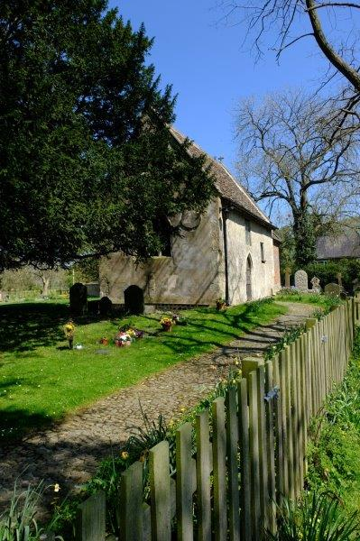 Saxon church partly concealed by trees