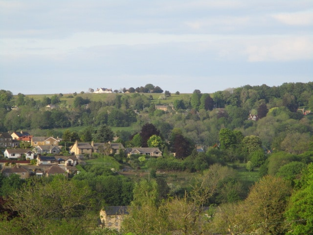 Minchinhampton Old Golf course and the Old Lodge on the horizon