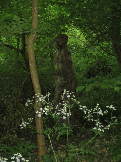 The statue hidden in the trees