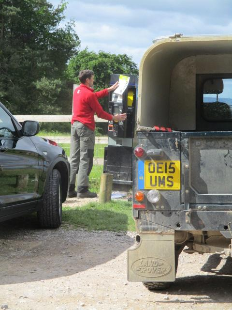 The National Trust car park machine isn't working. This man comes to mend it, but says we won't have to pay.