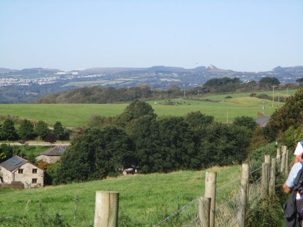 We head on the Saints Way parallel with the coast, Bodmin Moor and St. Austell in the distance