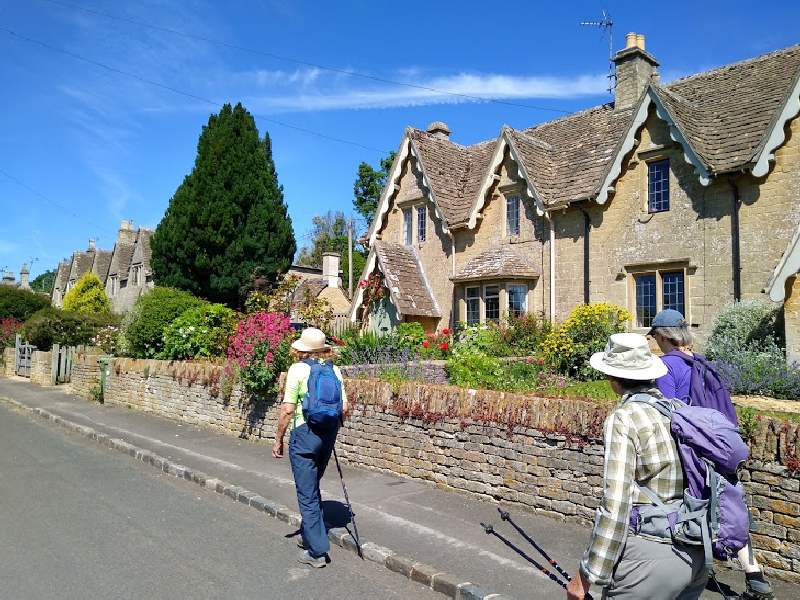 A sunny Monday morning. Four of us walk through the rebuilt village.