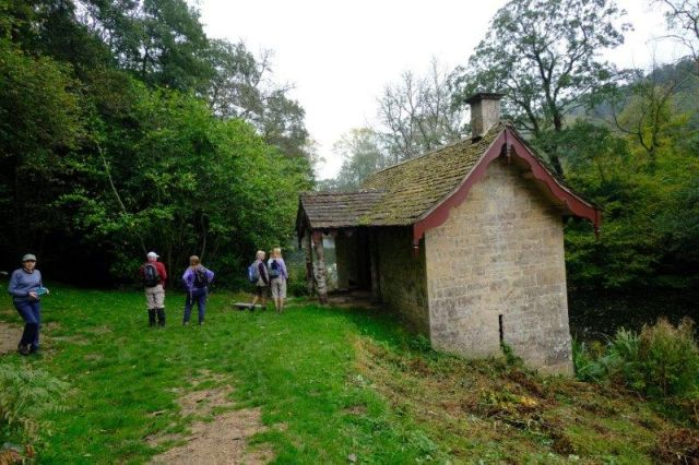 Alex leads us into Woodchester park and the boat house